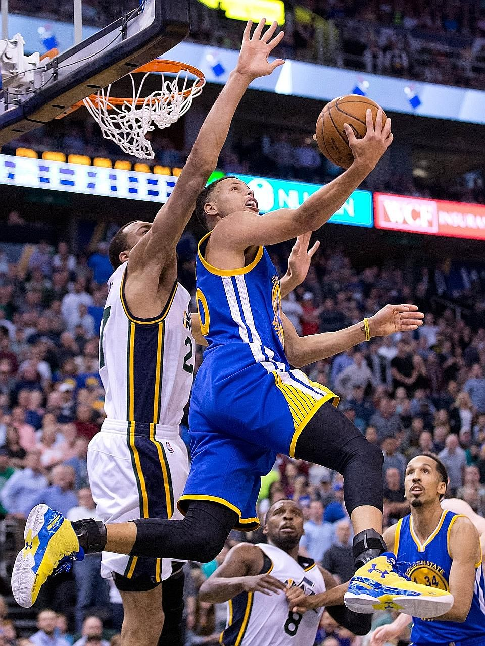 Golden State guard Stephen Curry going up for a shot as Utah centre Rudy Gobert blocks him. The Warriors won 103-96 in overtime and need just five more victories to exceed the Chicago Bulls' season best.