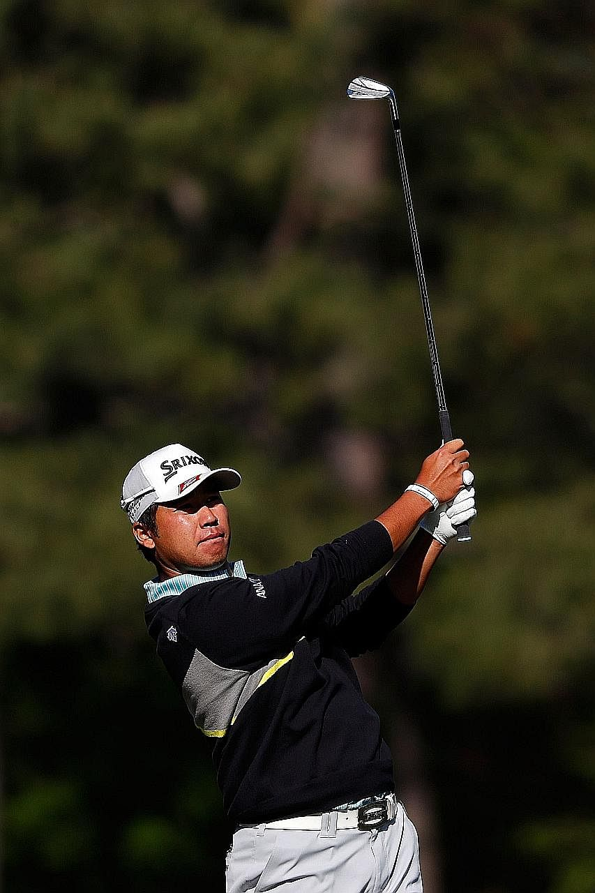 World No. 14 Hideki Matsuyama of Japan playing a shot on the 12th hole during the third round of the Masters. He ended the round two strokes behind leader Jordan Spieth.