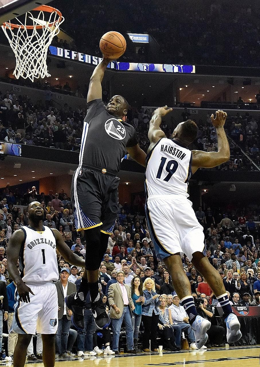 Draymond Green of Golden State going up for a shot as P.J. Hairston of Memphis fails to block him. The Warriors must win their last two regular season games to beat Chicago's record.
