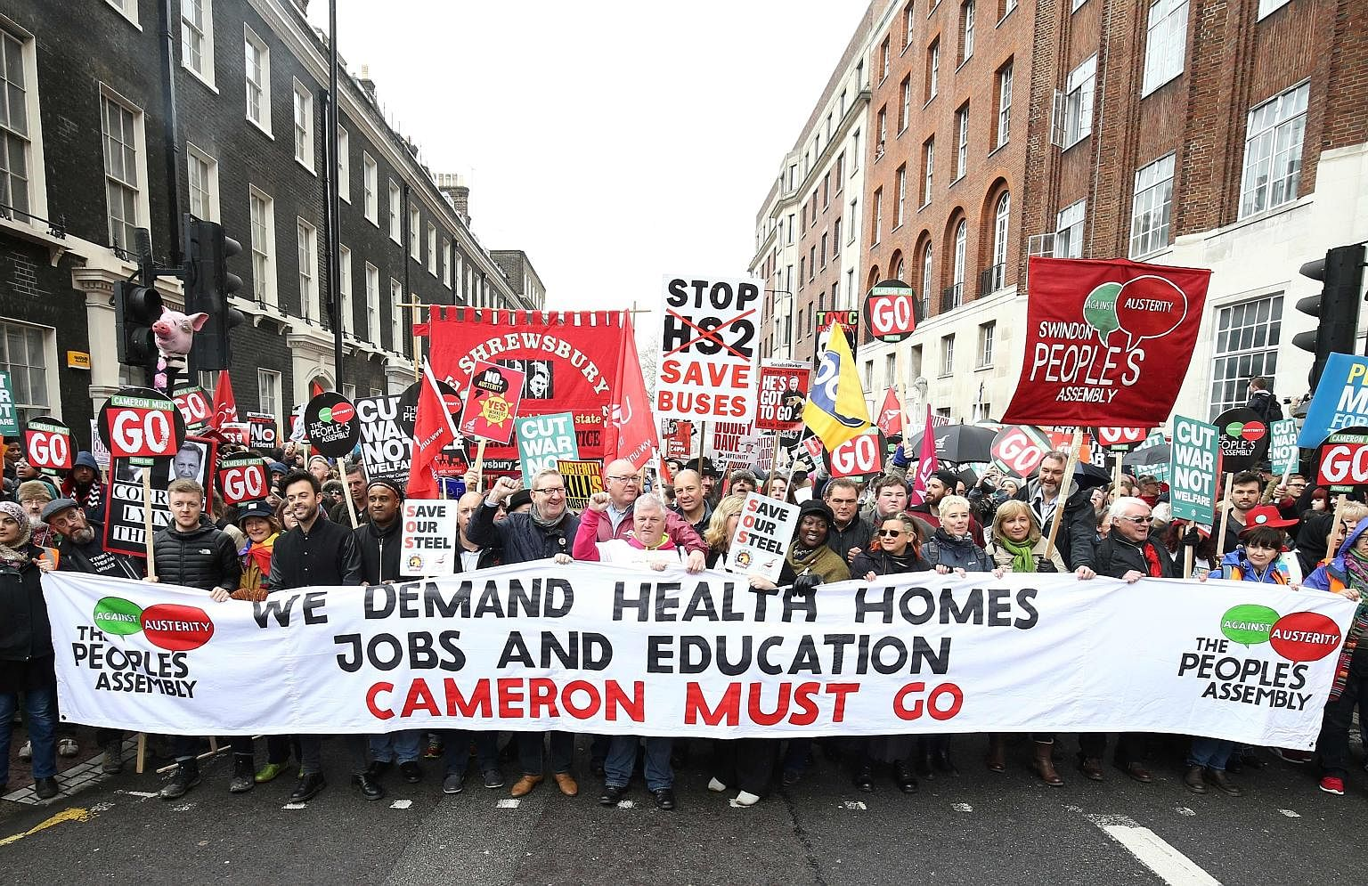 Protesters in Britain rallying over a variety of domestic issues, including a call for Prime Minister David Cameron to step down, during a march organised by the People's Assembly Against Austerity last Saturday.