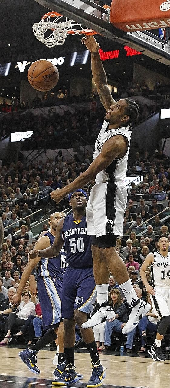 San Antonio's Kawhi Leonard dunking in front of Memphis' Zach Randolph in Game 2 of their Western Conference first-round series at AT&T Centre. The Spurs led by such a huge margin in the 94-68 win on Tuesday that their substitutes played for most of