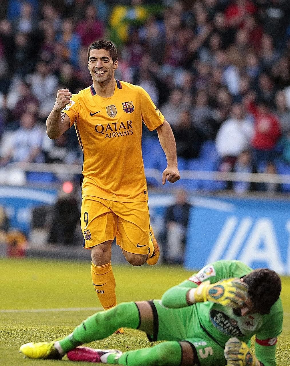 Luis Suarez celebrates completing his hat-trick against Athletic Bilbao. He later added another goal to take his season's tally to 30, clawing within one of Cristiano Ronaldo in the Pichichi standings.