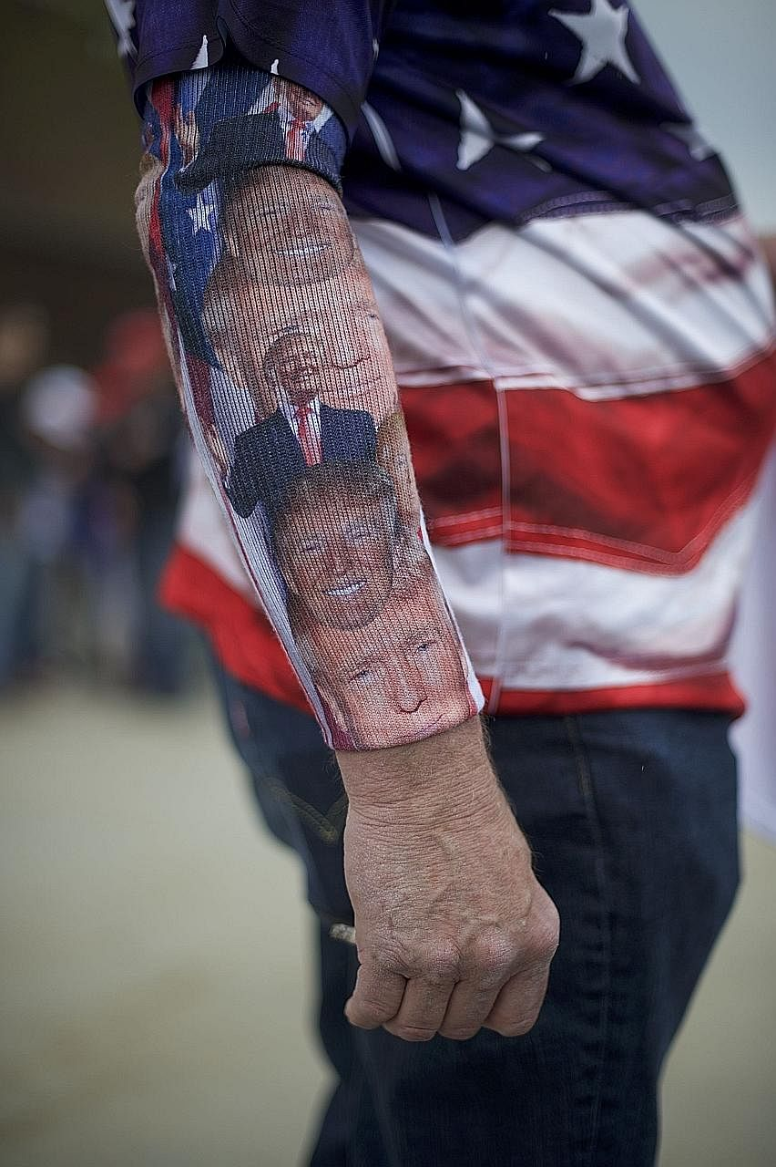 A campaign supporter wearing a Donald Trump-themed sock on his arm at a rally in Pennsylvania this week. Mr Trump has been firing up supporters with claims that party rules are rigged.