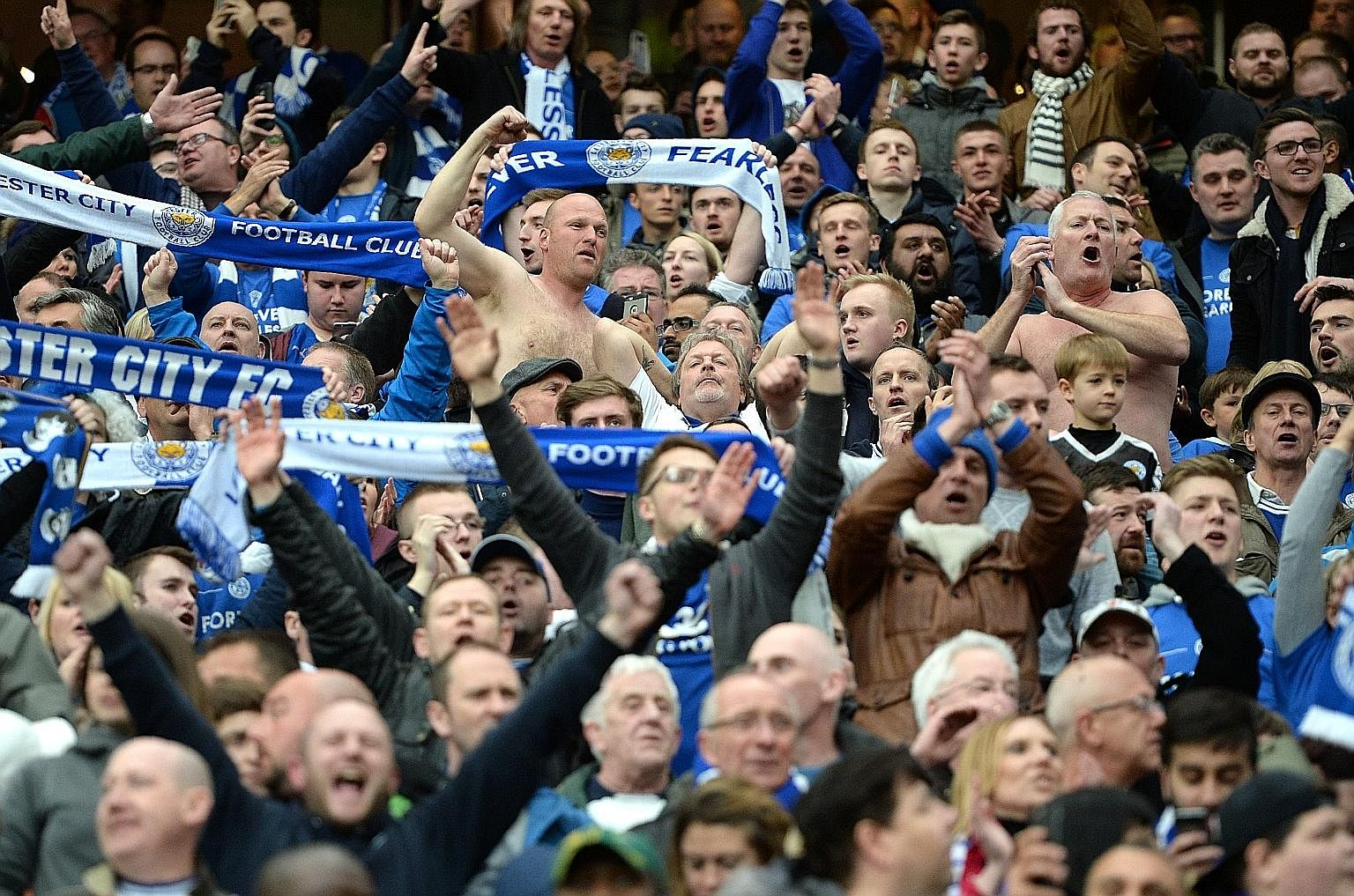 Leicester fans cheering after the English Premier League football match between Leicester City and Manchester United in Manchester on Sunday. The match ended 1-1.
