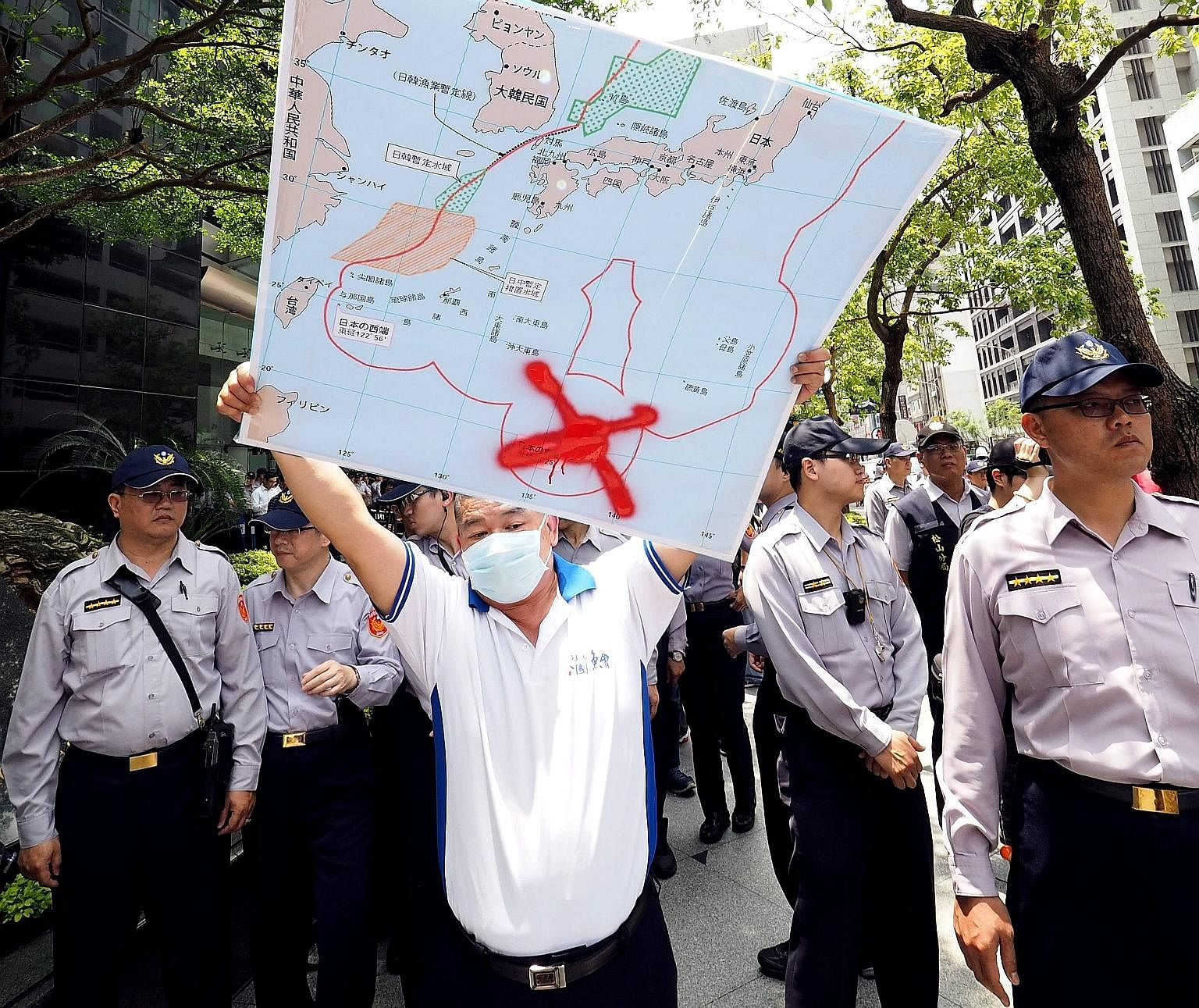 A Taiwanese fisherman with a map showing the location of Okinotorishima Island crossed out, during a protest last month over Japan's seizure of a Taiwanese trawler there.
