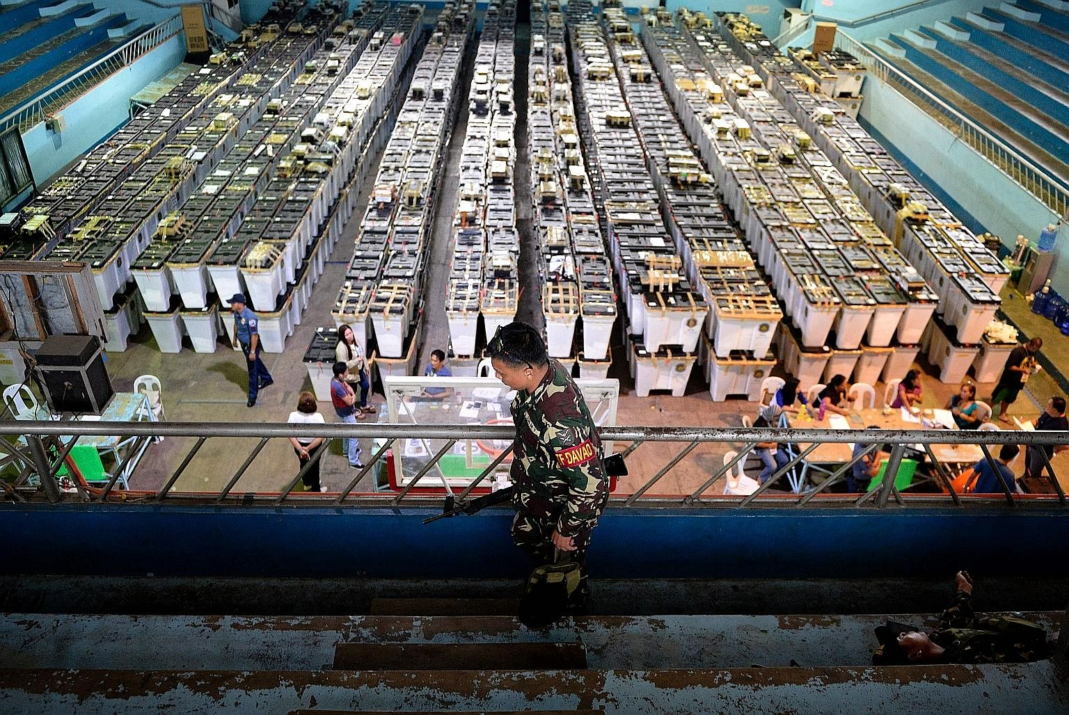A soldier patrolling near election paraphernalia at Almendras Gym in Davao city, on the southern Philippine island of Mindanao, yesterday. In Monday's presidential election, Mr Duterte beat four other candidates after winning the support of the middl