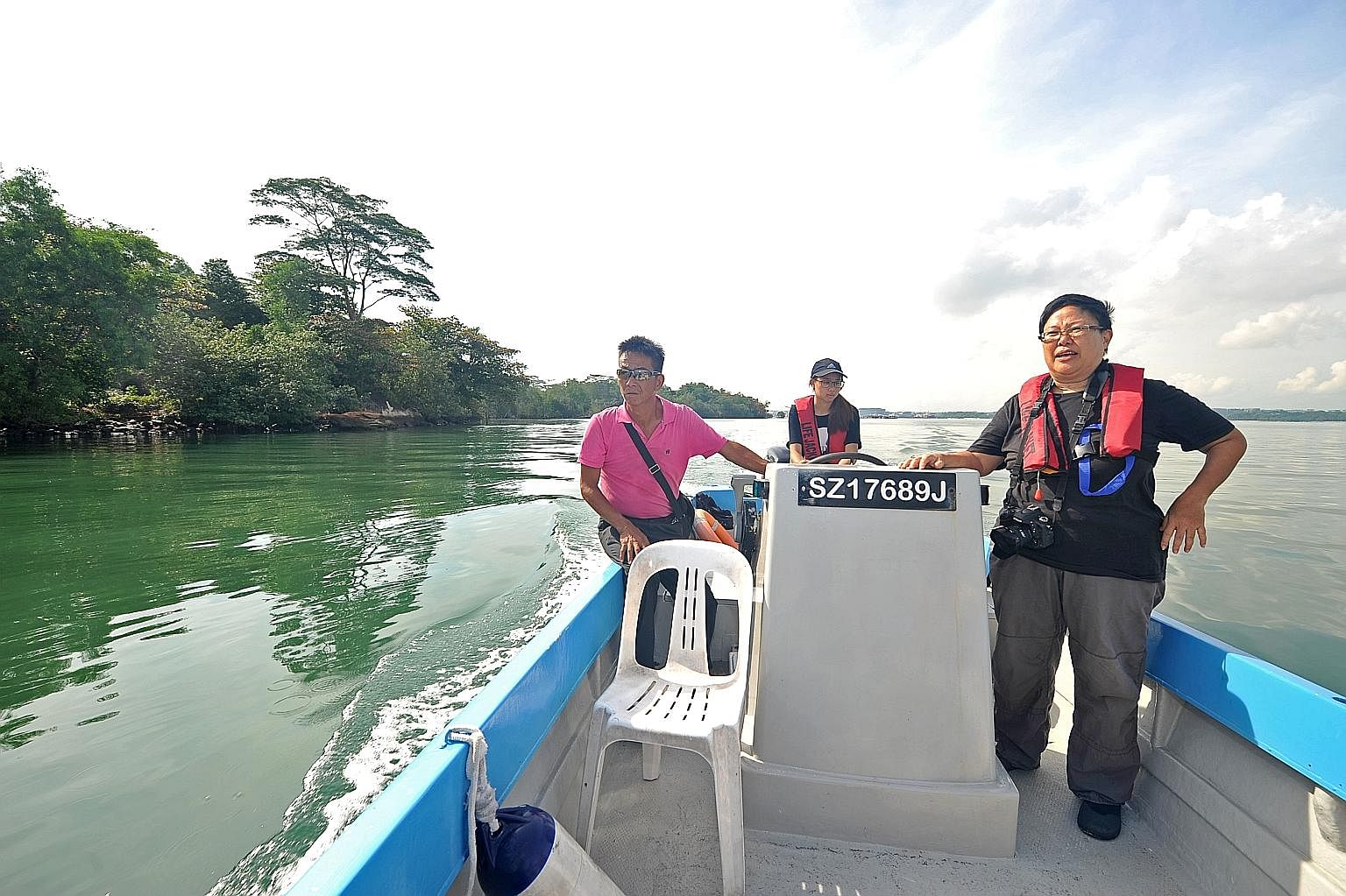 (From left) Ubin fish farmer Philip Lim, geography student Vanessa Teo and Pesta Ubin coordinator Ria Tan on a boat tour through Ubin's mangroves. Go kayaking at Ubin Quarry (above) with Outward Bound Singapore instructors. Explore Ubin town.