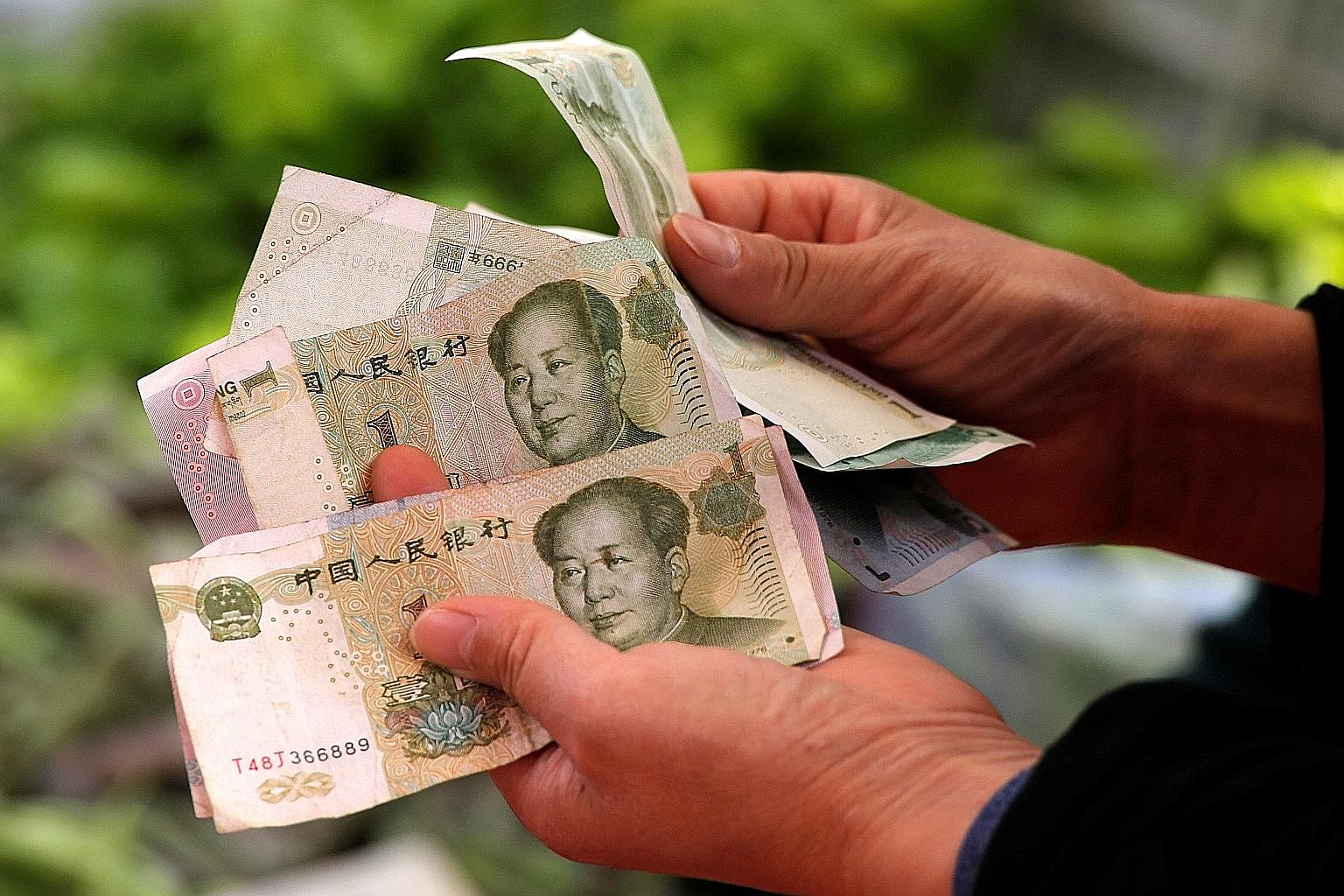 """Even as the yuan becomes more widely used, whether or not it can become a trusted """"store of value"""" for central banks around the world - comparable to the greenback, pound, euro and yen - will depend on the success of financial market reforms in China"""