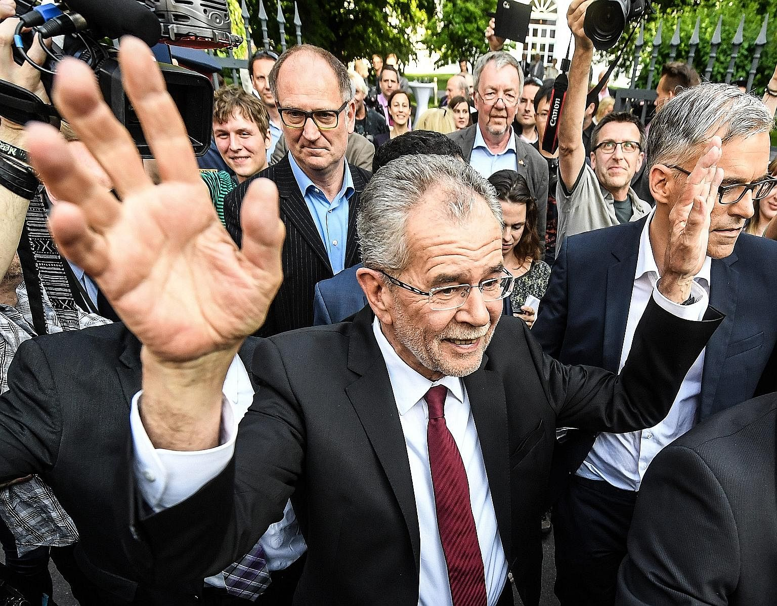 Austrian President-elect Alexander Van der Bellen, who is supported by the Green Party, waving after delivering a statement on Monday, following the presidential election run-off.