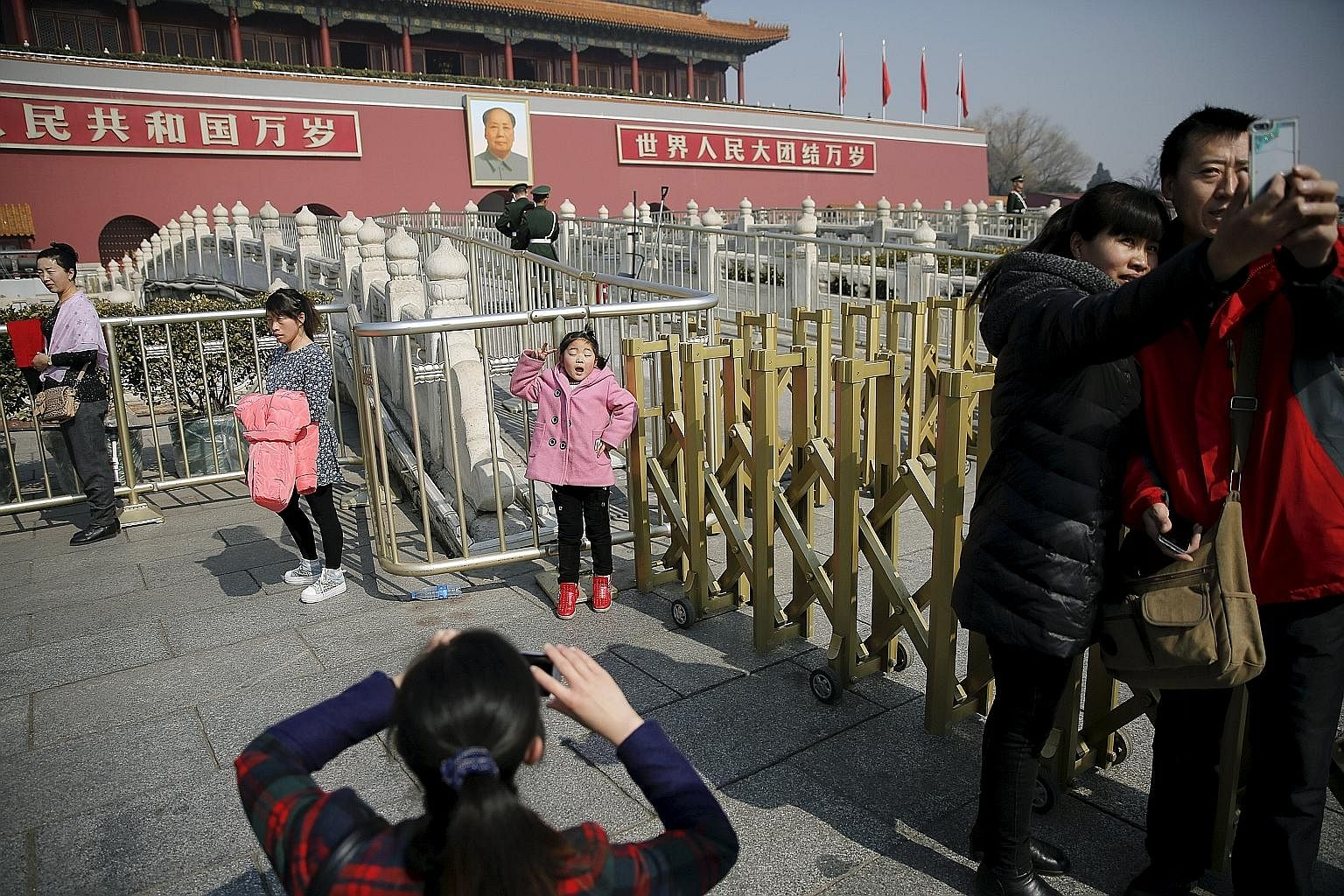 Picture-perfect moments in front of Tiananmen Gate near the Great Hall of the People. The writer has found the Chinese to be creative individuals, surviving - even thriving - in a world of censorship by developing a sense of humour. They are, in thei