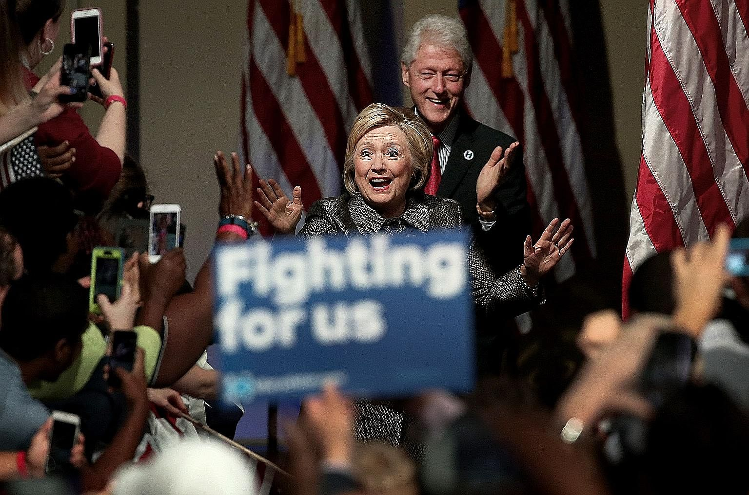 Mrs Hillary Clinton arriving with her husband, former president Bill Clinton, at a campaign event in Philadelphia last month. Mr Clinton's years in office were marked by a very impressive economic boom.