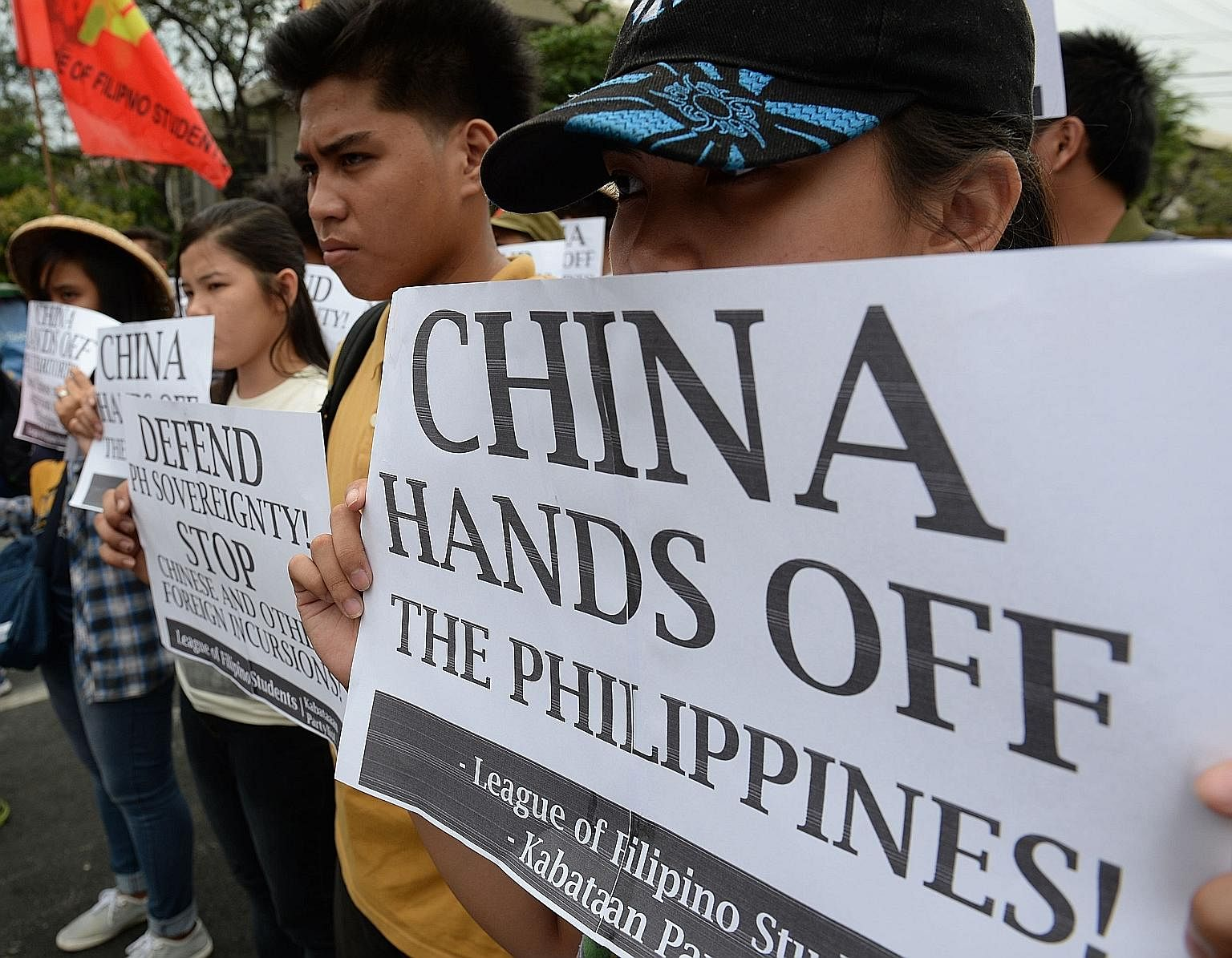 Filipino students holding anti-Chinese placards during a rally in Manila in March against Chinese vessels reportedly dropping anchor near a South China Sea atoll also claimed by the Philippines.