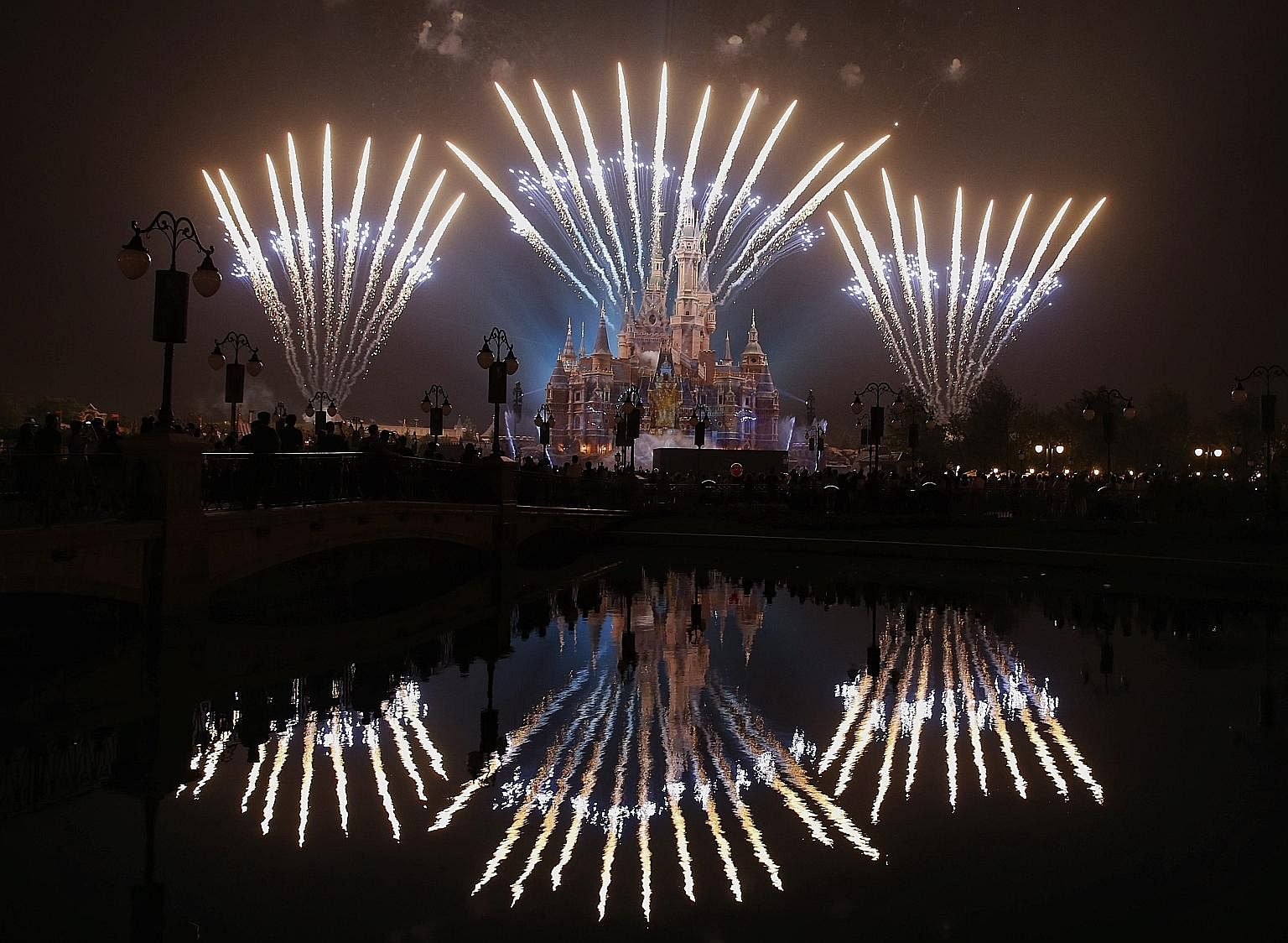 Fireworks lighting up the Enchanted Storybook Castle at the Shanghai Disney Resort which will officially open on June 16.