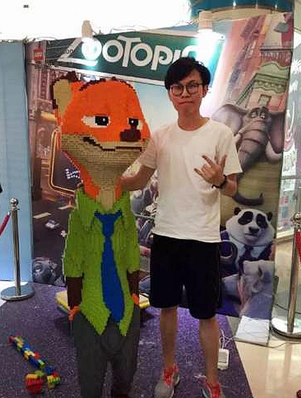 Mr Zhao (left) worked for three days and nights without a break in order to complete a sculpture of Disney character Nick Wilde, in time for an exhibition at a shopping mall in the Chinese city of Ningbo. The fox statue had been on display for only a