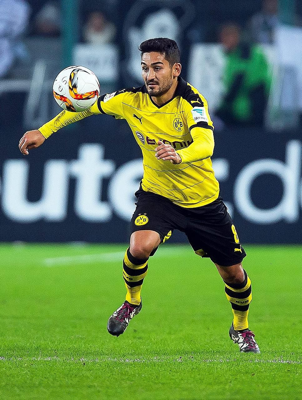 Ilkay Gundogan in action during a German Bundesliga match in January. The midfielder dislocated a knee cap in early May but Manchester City say he is recovering well from the injury.