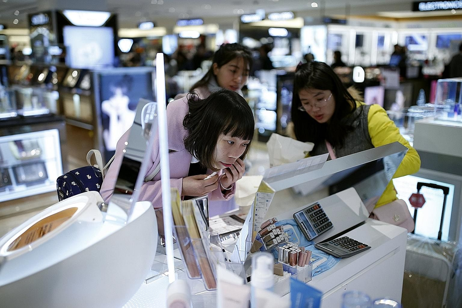Chinese tourists, seen here in a shop in Seoul, are snapping up foreign goods for their quality and variety as China's manufacturers are not meeting the demands of its increasingly savvy and affluent consumers.