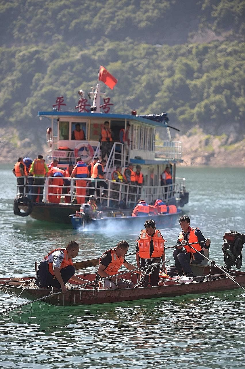 Chinese search- and-rescue workers using magnetic positioning devices and underwater cameras to search for survivors after the leisure boat Shuanglong capsized in Bailong Lake amid strong winds on Saturday.