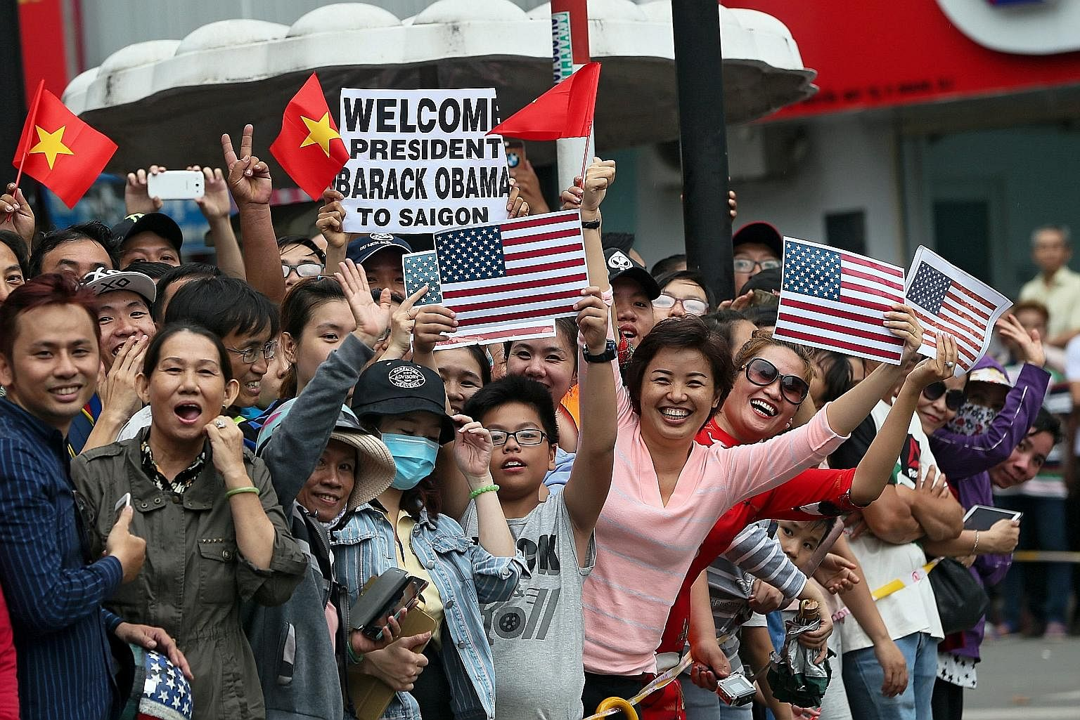 In a show of US soft power, people lined the streets of Hanoi and Ho Chi Minh City (above) to welcome Mr Obama last month.