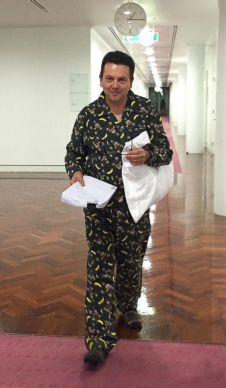 Mr Xenophon arriving in Parliament dressed in pyjamas. The independent MP from South Australia has become known for his headline-grabbing political stunts, often involving costumes or animals.