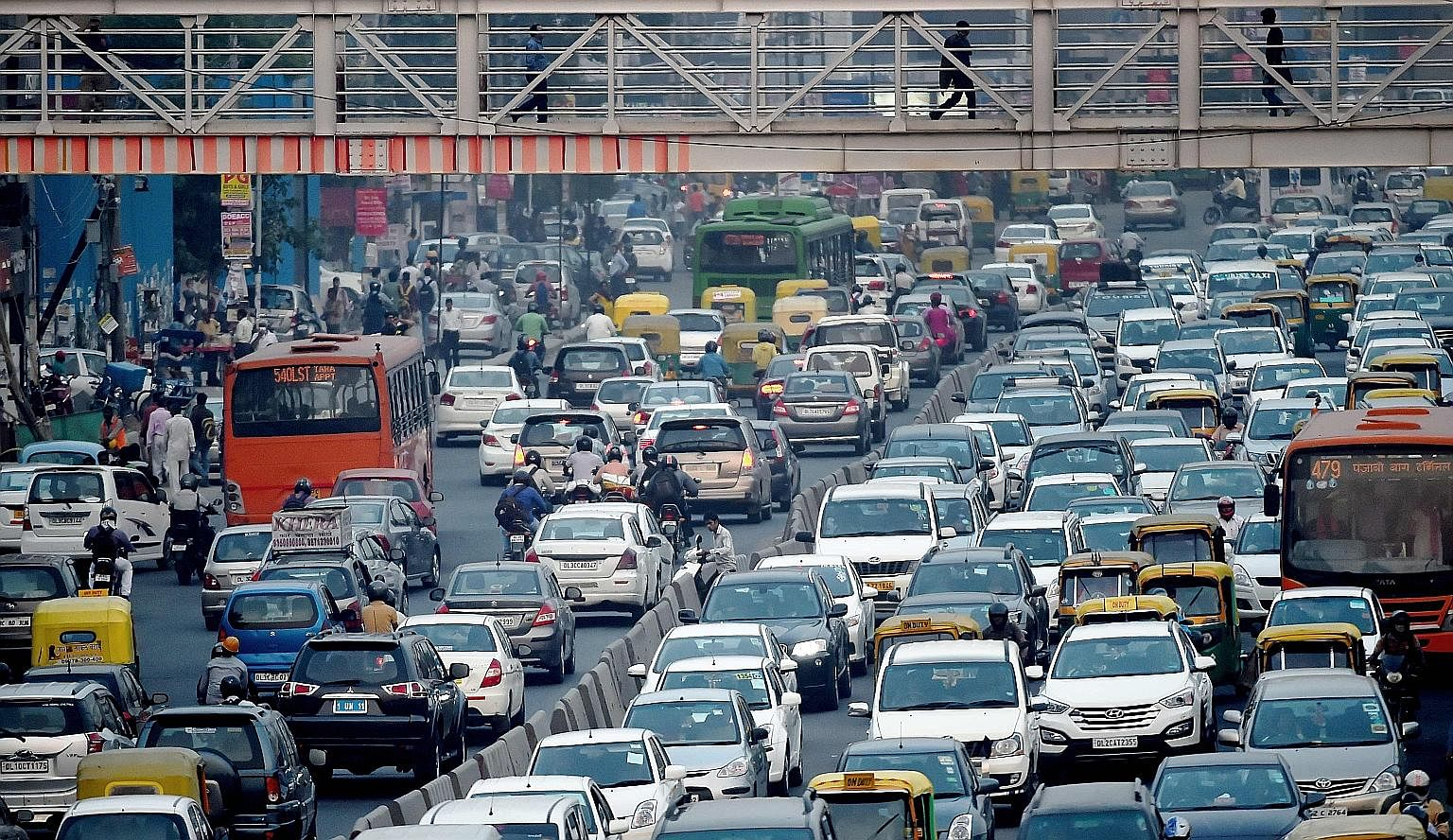 Nations like India, whose cities are beset by slums, yearn for a prosperous urban future. But getting there will require major governance and policy changes. This is because their cities, such as India's New Delhi (above), are places where traffic cr