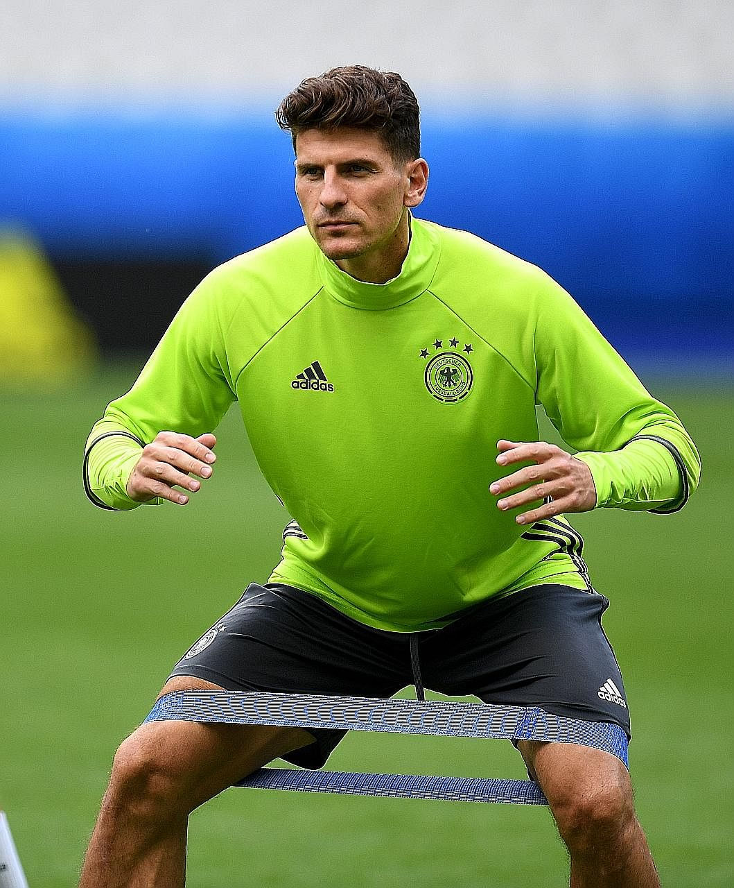 Germany striker Mario Gomez warming up with a rubber band during training. The Germans have been reaping the benefits from Patrick Broome's addition to the backroom staff along with his yoga methods.