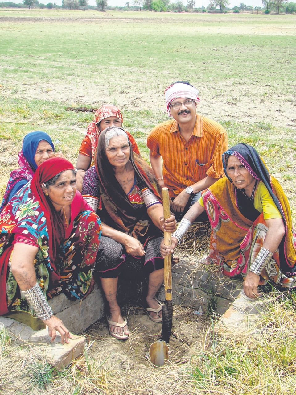 Naireeta Services director Biplab K. Paul with village women who have benefited from Bhungroo, a water management system.