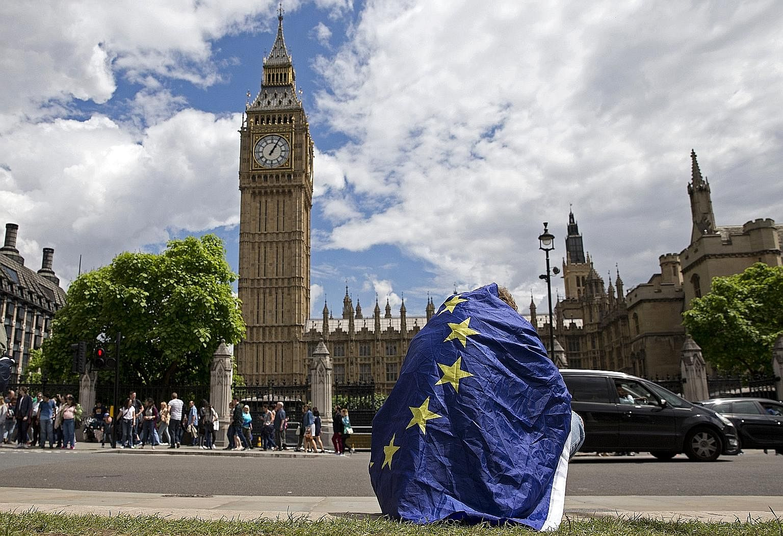 A demonstrator draped in the EU flag in London protesting last Saturday against the outcome of the referendum.