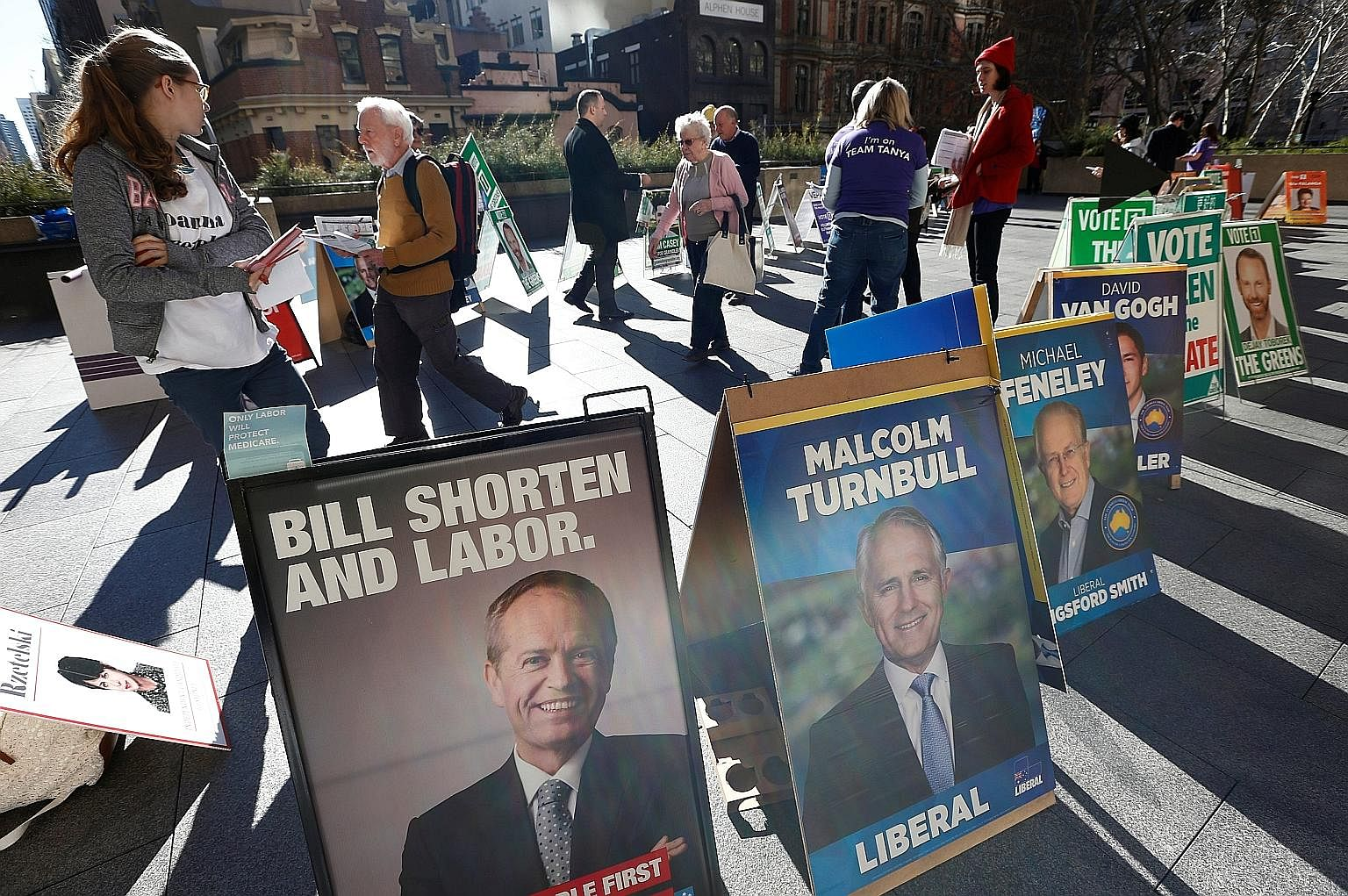 Candidates like Mr Shorten (above, left, featured in a promotional poster near a Sydney polling centre) and Mr Turnbull have mostly kept their campaigns free of the vitriol seen in other recent political contests.