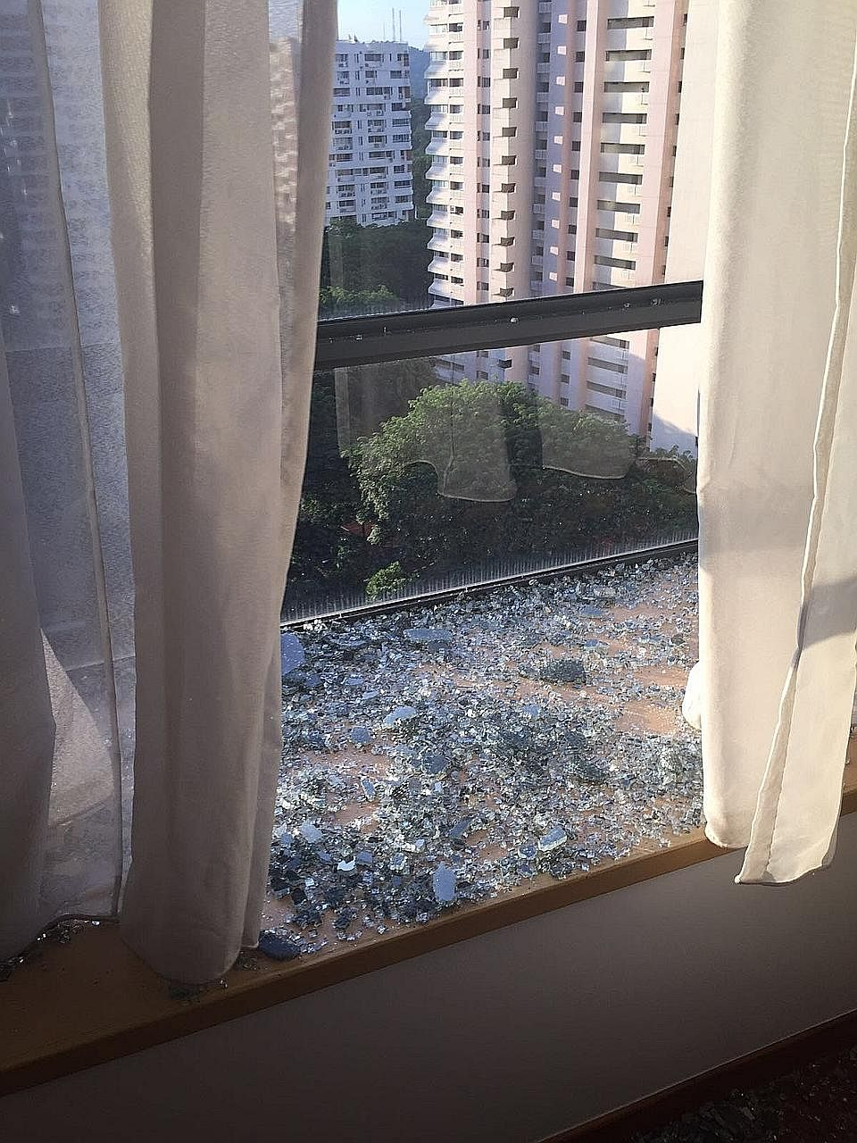The shattered window at the home of Mr David. Over the past four years, BCA has received an average of 15 reports on glass shattering per year from a total of 25 condos.