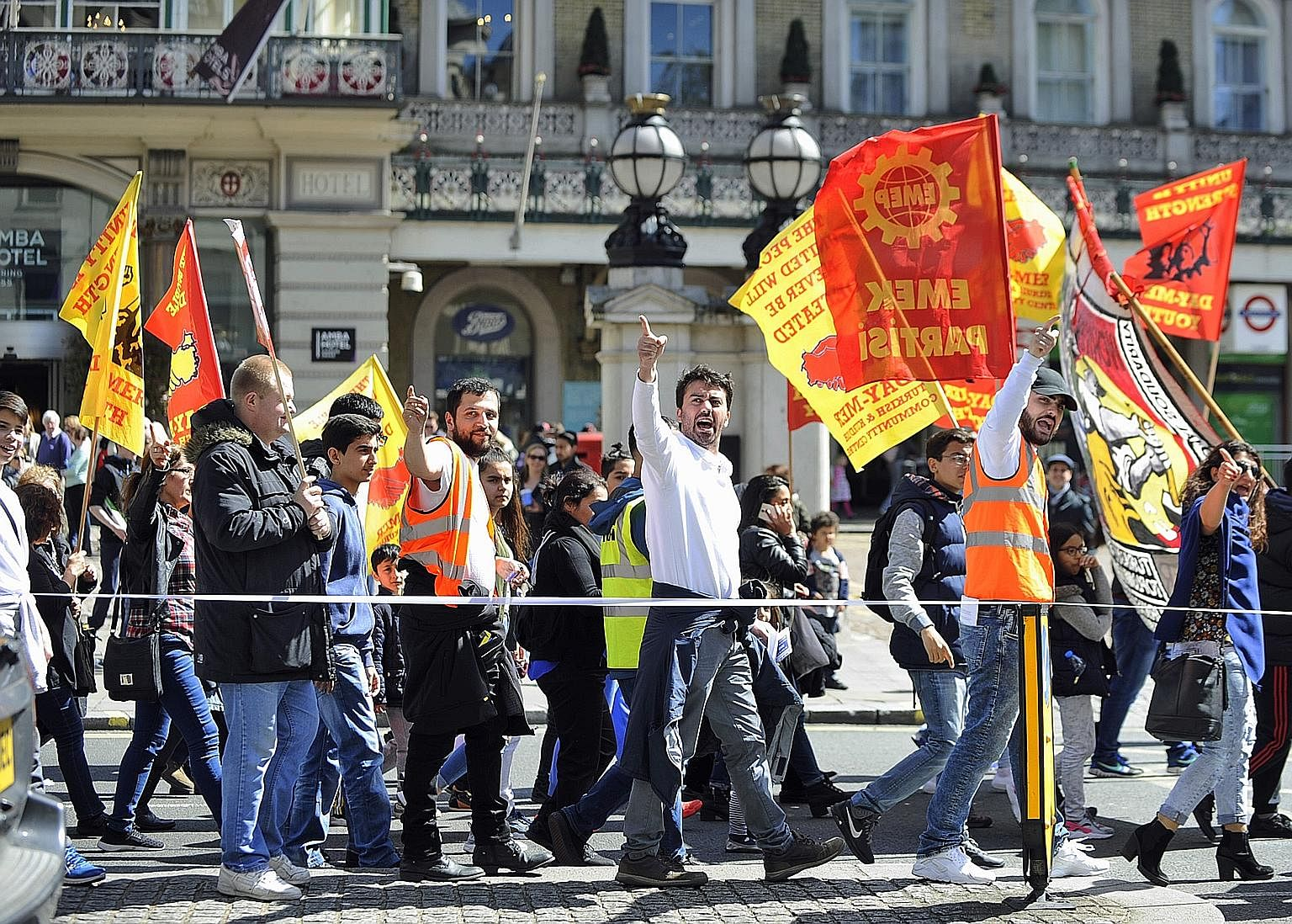 Protesters holding a May Day march in London. Left unchecked, globalisation has been shown to widen the income gap and negatively affect the standard of living of the average citizen. Wealth is largely concentrated in the pockets of the moneyed elite