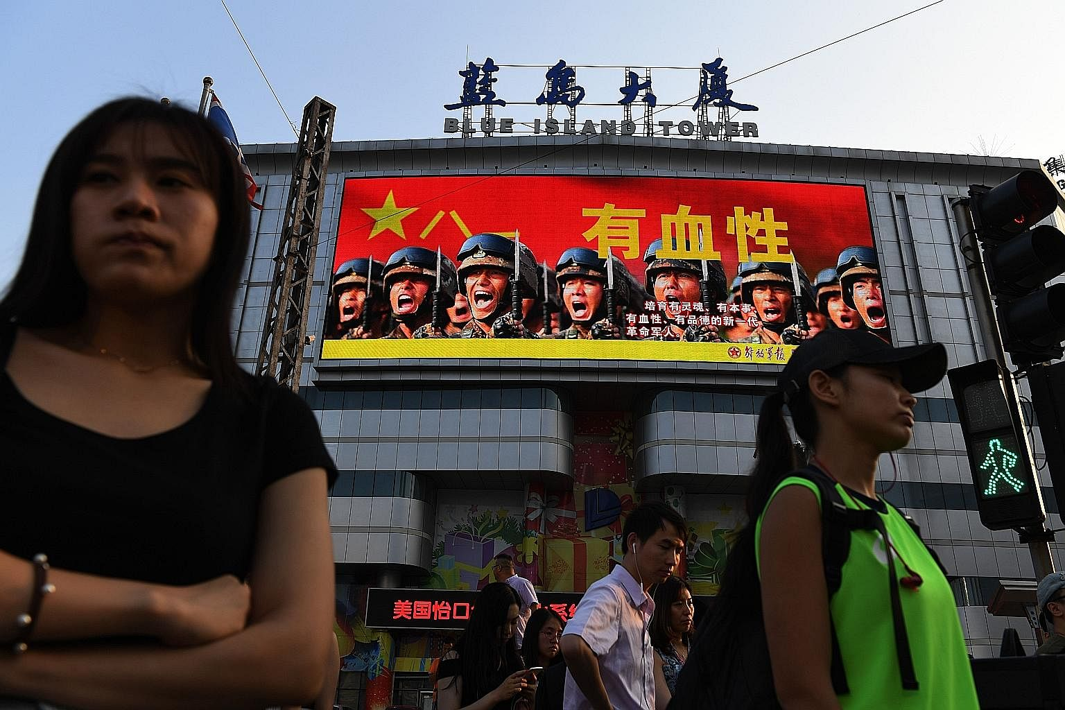 """A military recruitment advertisement at a shopping mall in Beijing. Editorials in publications such as the Global Times declare that China """"must be prepared for any military confrontation""""."""