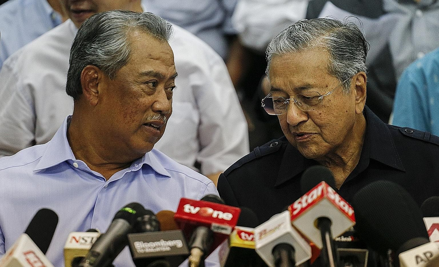Dr Mahathir (right) with Tan Sri Muhyiddin at a media event in March. Dr Mahathir's move to force a change of leadership from outside Umno shows he no longer has clout within the ruling party. But it is not known what position Mr Muhyiddin, Umno's fo