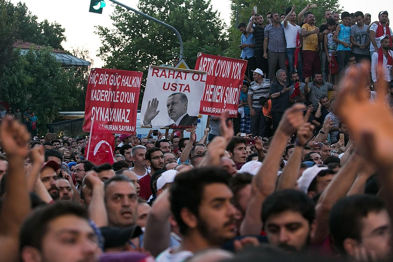 Pro-Erdogan supporters at a rally near the Turkish President's house in Istanbul last Saturday after the Turkish authorities wrested back control of Ataturk airport.