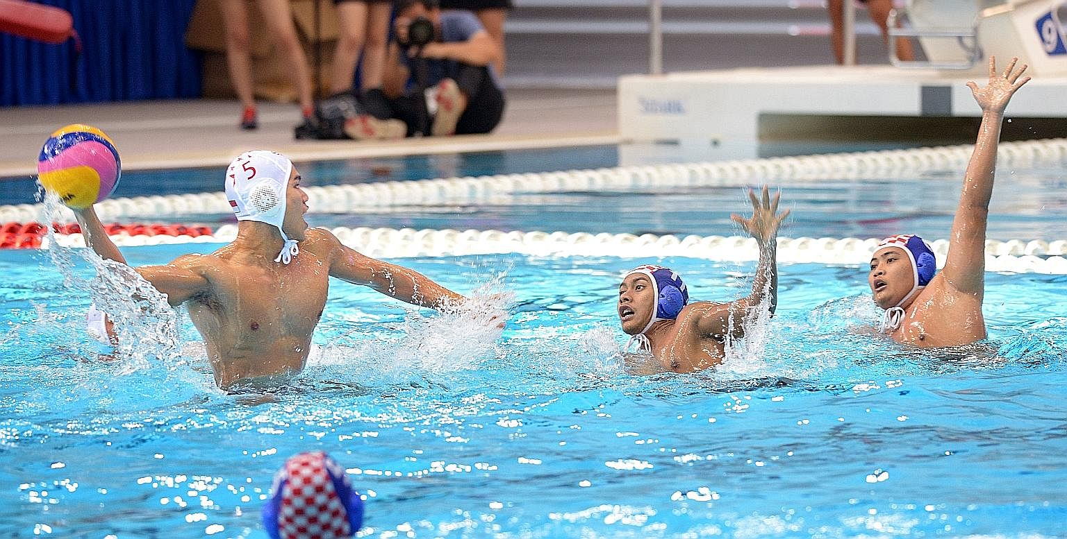Ooi Yee Jia taking a shot as two Indonesian players attempt to block him in the final at the OCBC Aquatic Centre. Singapore edged out Indonesia 10-9 to win the AUG's final gold medal. Thailand thrashed the Philippines 17-7 for bronze.