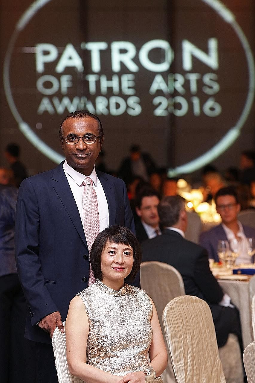 First-time recipients of the Distinguished Patron of the Arts award Joseph and Emma Cherian. They contributed to the National Gallery by adopting Malaysian artist Chia Yu Chian's 1960 oil painting of a village scene.