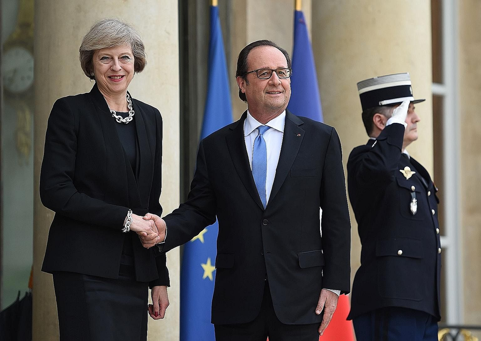 Mr Hollande welcoming Mrs May to the presidential Elysee Palace on Thursday.