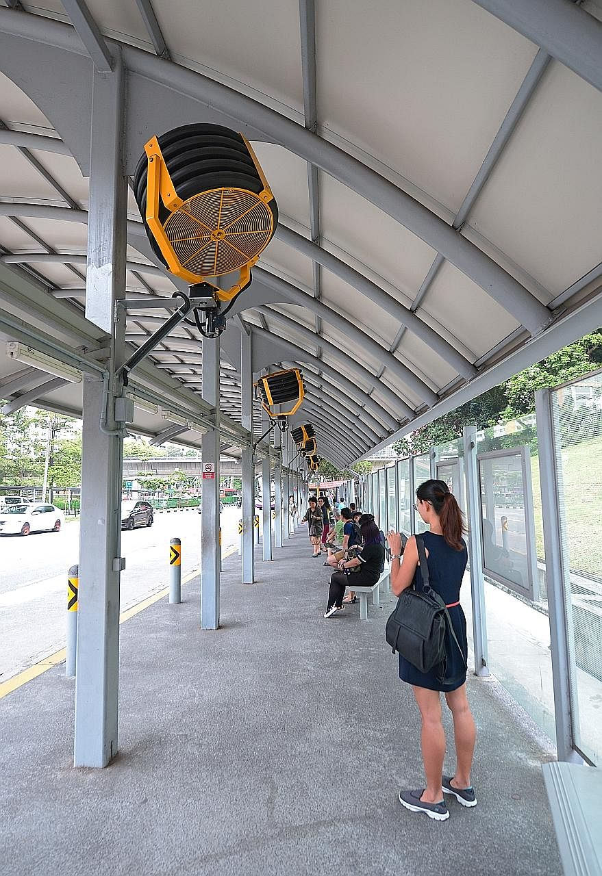 Oscillating fans at the bus stop along Ang Mo Kio Avenue 3, near Ang Mo Kio MRT station. The LTA is studying the feasibility of installing these, as well as linear-type fans for low-roofed sites, at other bus stops.