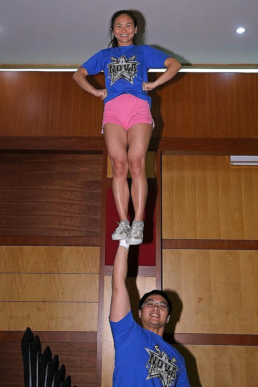 Ms Teo with her cheerleading partner Tan Ka Hau. Ms Teo is a flyer, a cheerleader who is lifted into the air during stunts. Her cheerleading started in Temasek Polytechnic, where she joined its cheer team for a year.
