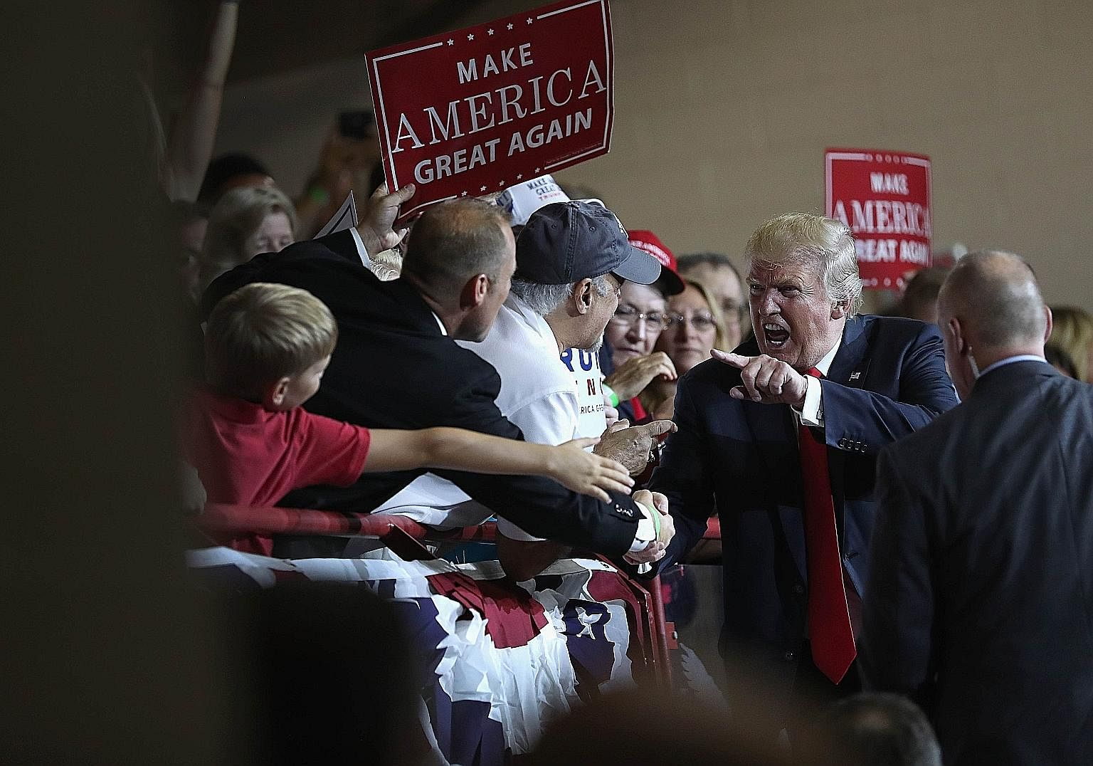 Mr Trump interacting with supporters on Monday after a campaign rally in Pennsylvania. He has specialised in the erratic and abusive, and is using a foghorn to appeal to racist sentiment.