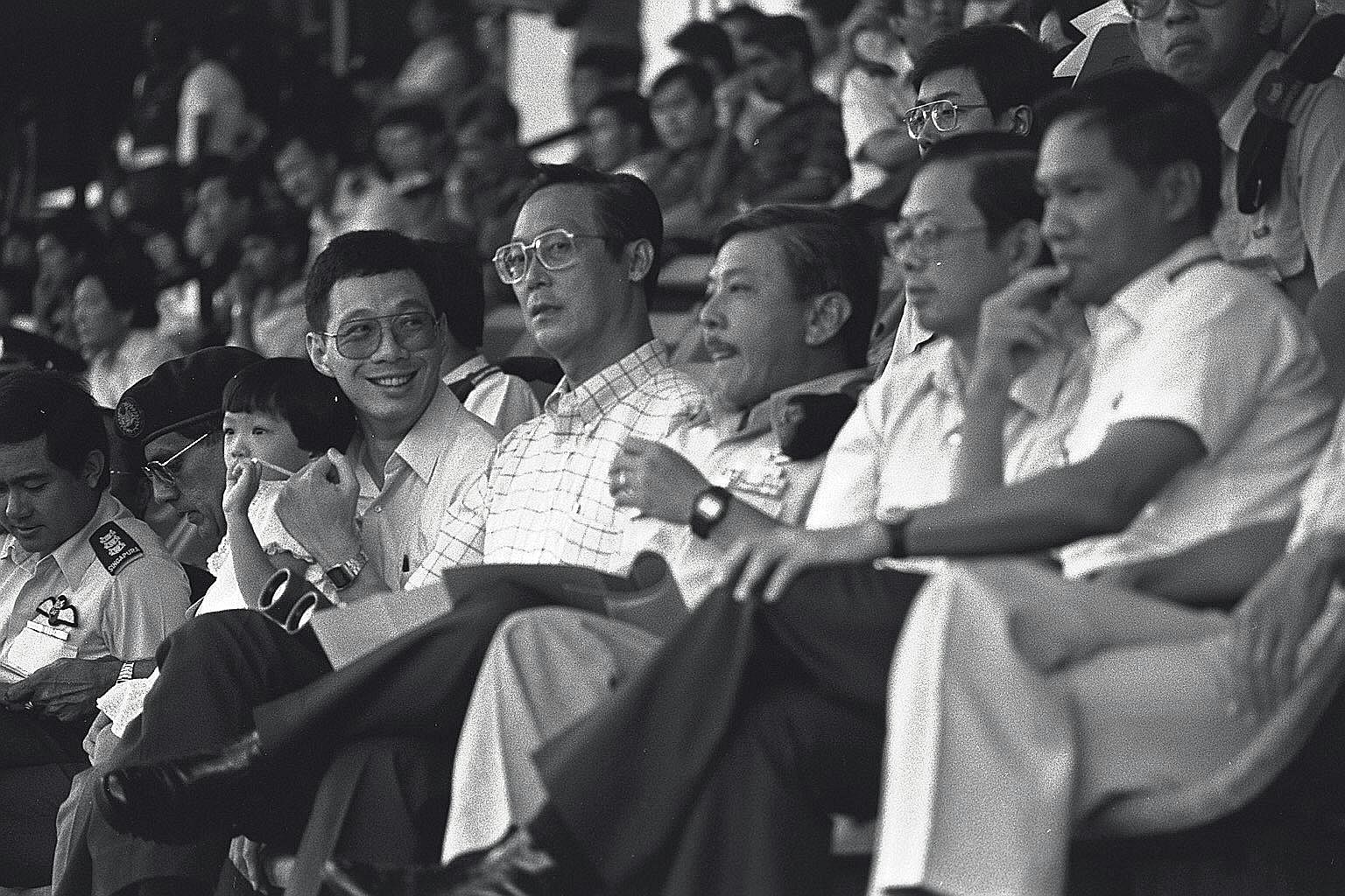 Mr Lee, then Minister of State, with his daughter Xiuqi, First DPM Goh Chok Tong and SAF Chief Winston Choo at the NDP 1985 rehearsal.