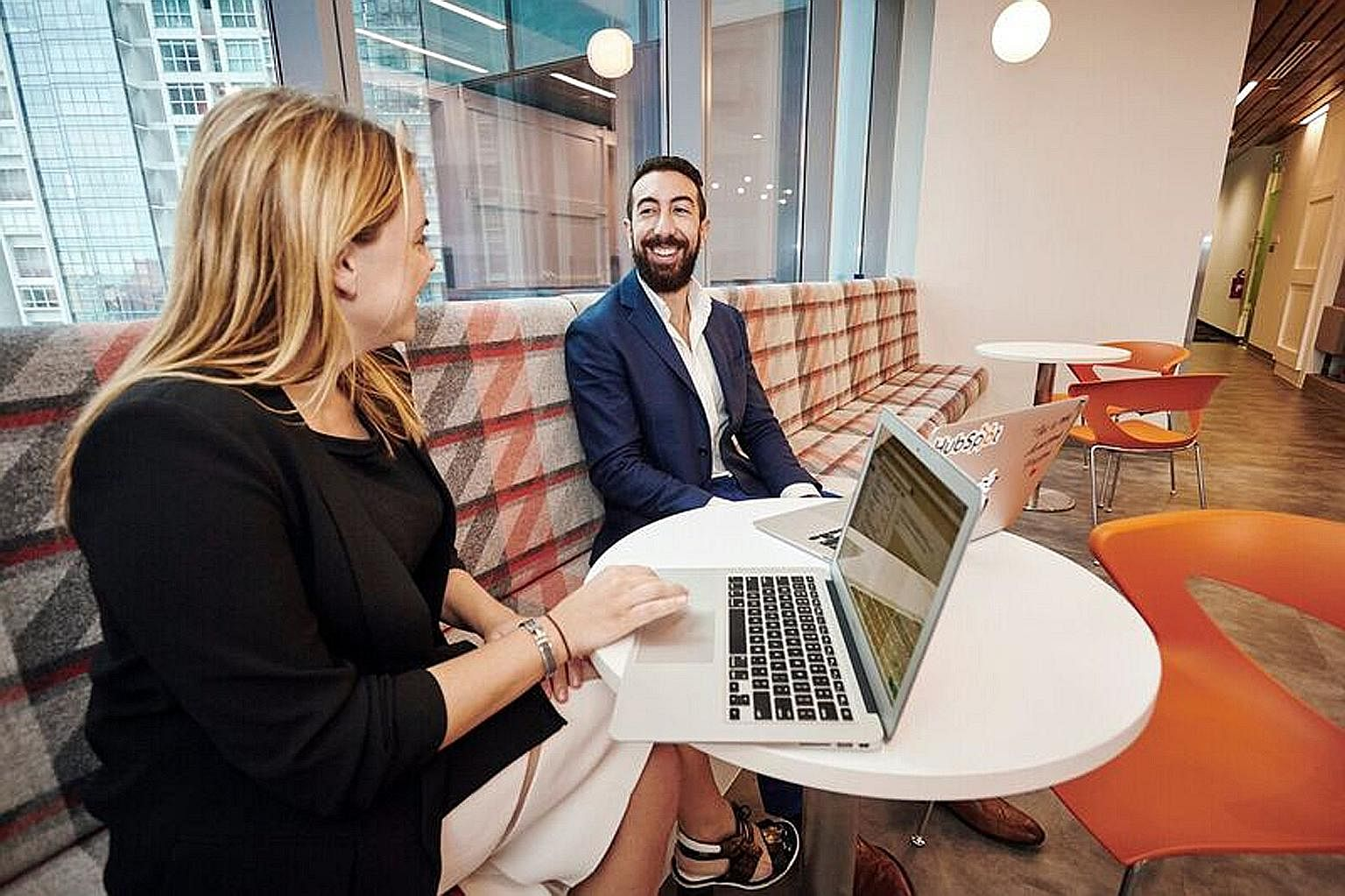 """Employees in HubSpot's trendy office can choose to work anywhere that best suits them. Such concepts allow better collaboration and build a strong sense of community, says its managing director. """"Not even our chief executive has his own office."""""""