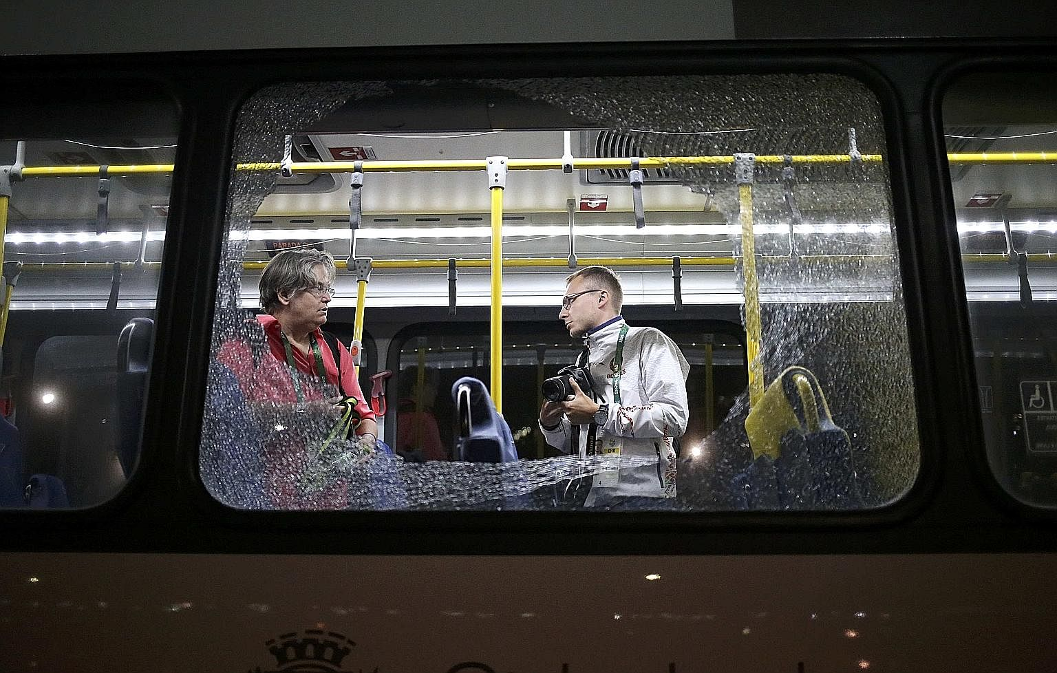 "Broken windows on an official media bus which shattered when journalists were driven from the Main Transport Mall from the Deodoro venue were originally feared to be caused by gunfire. But it turned out to be an ""act of vandalism"" carried out with ro"