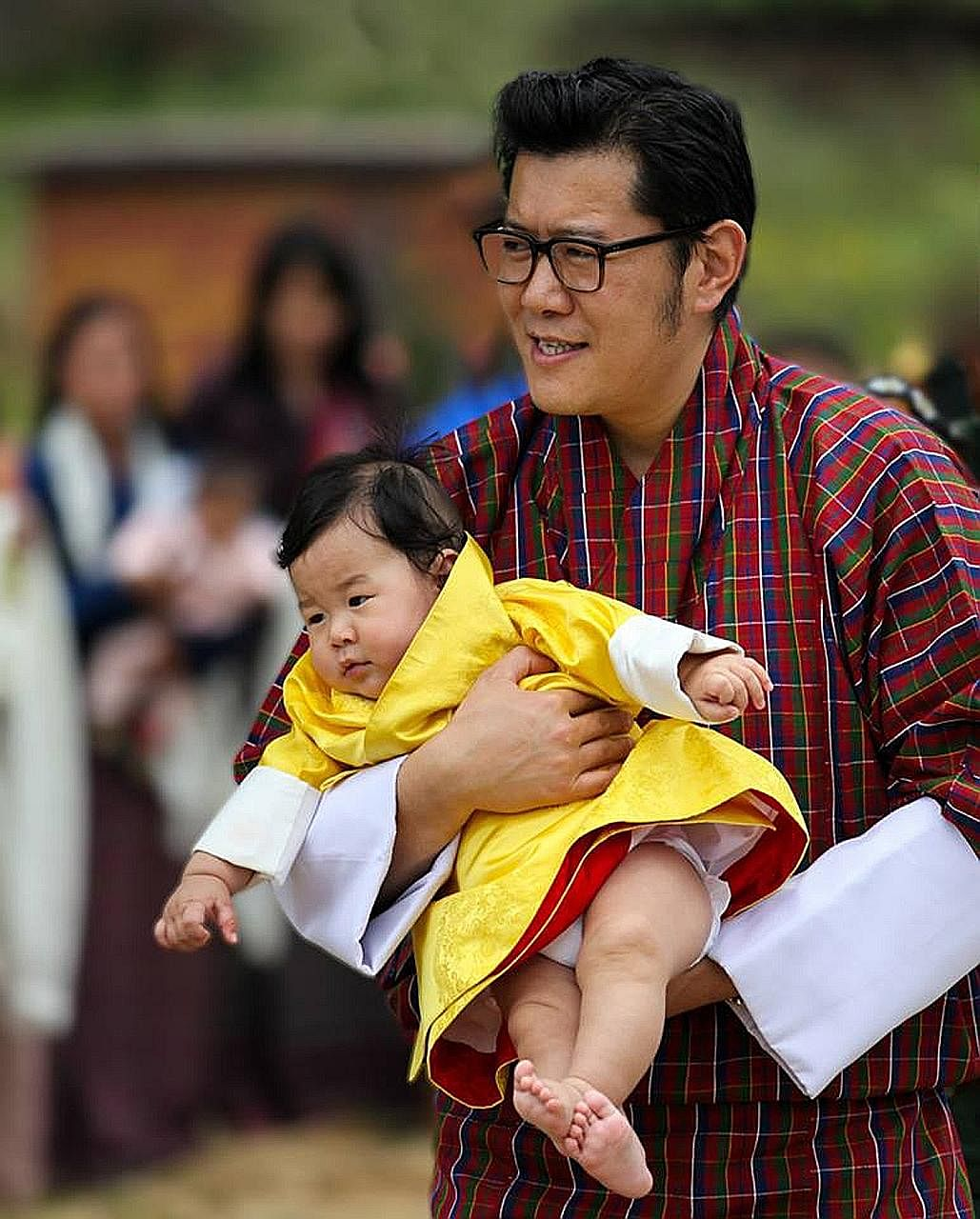 Bhutan's King Wangchuk with his son Jigme Namgyel Wangchuck during a royal visit to Bumthang district. The prince's photos were posted on the Facebook pages of the royal couple.