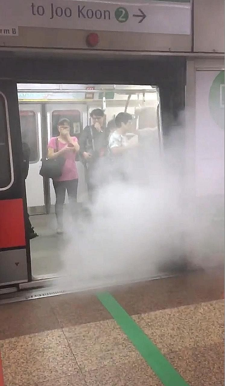 """Freon gas leaking out onto a platform at Tanjong Pagar MRT station yesterday. It appeared to be """"coming out from underneath the train"""", from the gap between the train and the tracks, according to a commuter. The train has been withdrawn from service,"""