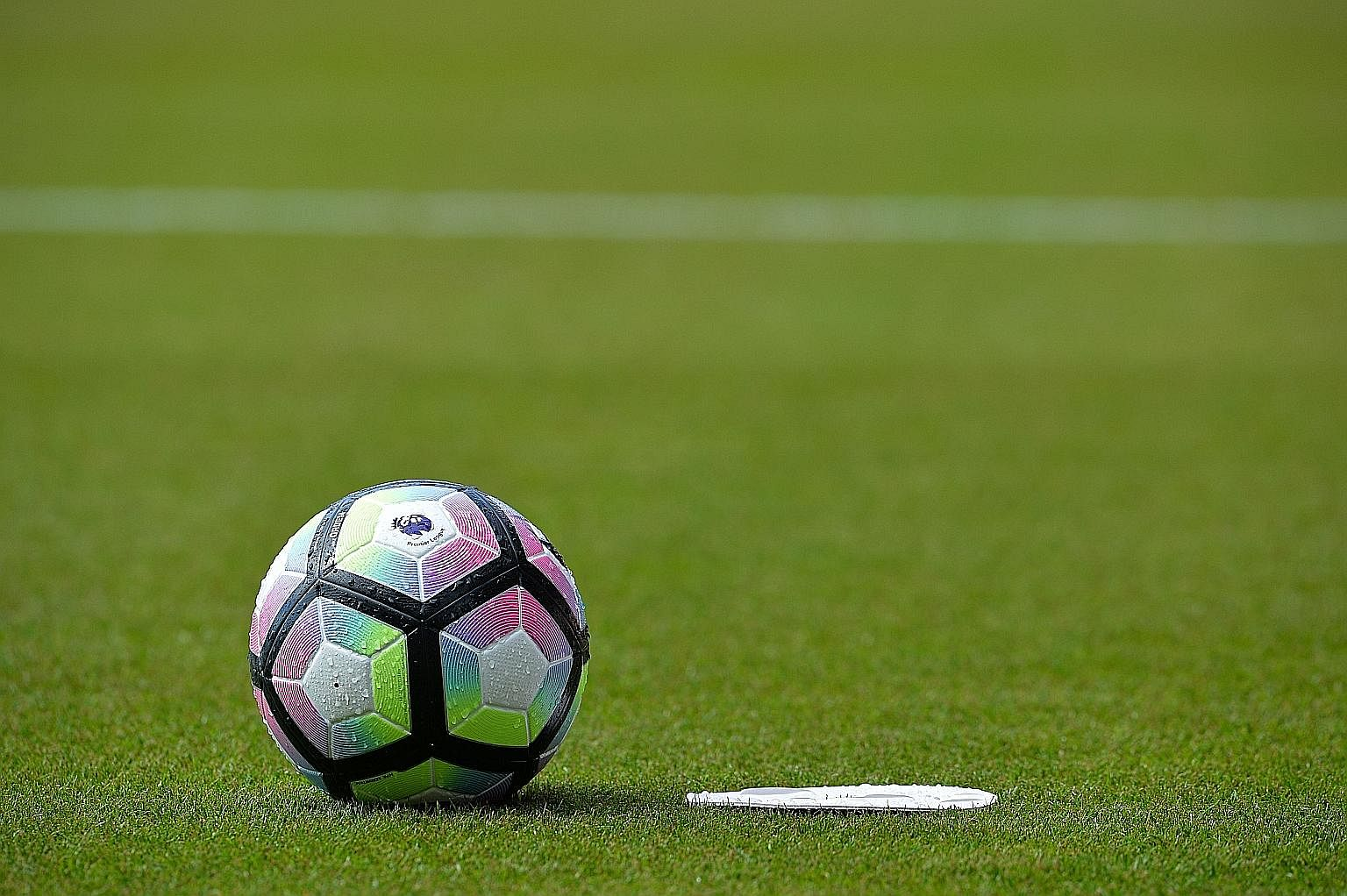 """A new Premier League football on the pitch during the match between Bournemouth and Manchester United at the Vitality Stadium in Bournemouth on Sunday. Premier League chief executive Richard Scudamore described the league as """"open for business, open"""