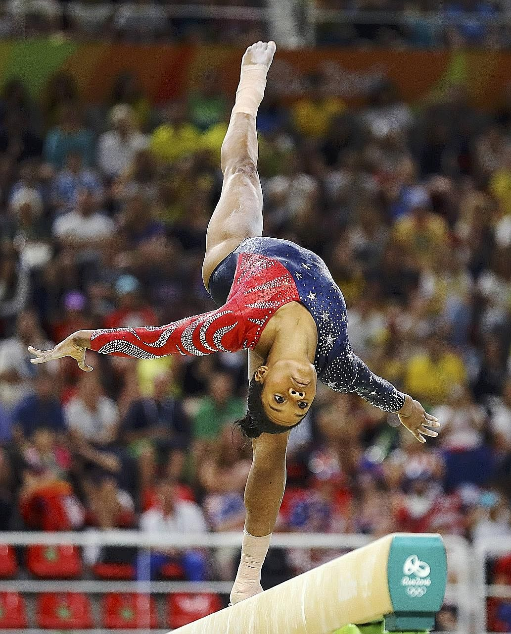 US gymnast Gabby Douglas performing at the 2016 Rio Olympics. In the run-up to the London Games in 2012, it was said that her mother had filed for bankruptcy, brought on partly by the high cost of the gymnast's training.