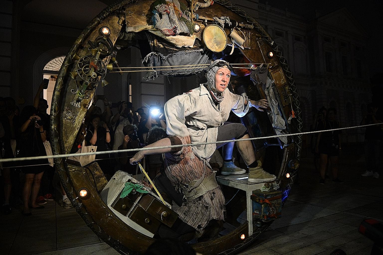 The Story Box is a playful work by American artist a dandypunk. The Wheel House by Acrojou features a man and a woman who live in a handbuilt, mobile circular house.