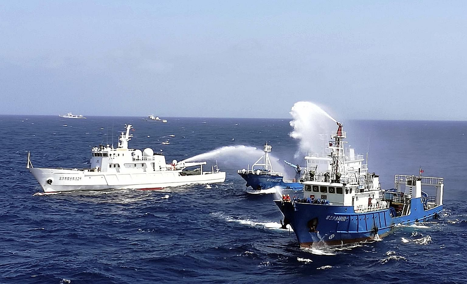 Chinese ships put out a fire on a cargo vessel during a drill in the South China Sea near Hainan province last month. China warned then that it would respond decisively to provocations in the South China Sea, as it faced mounting pressure to accept a
