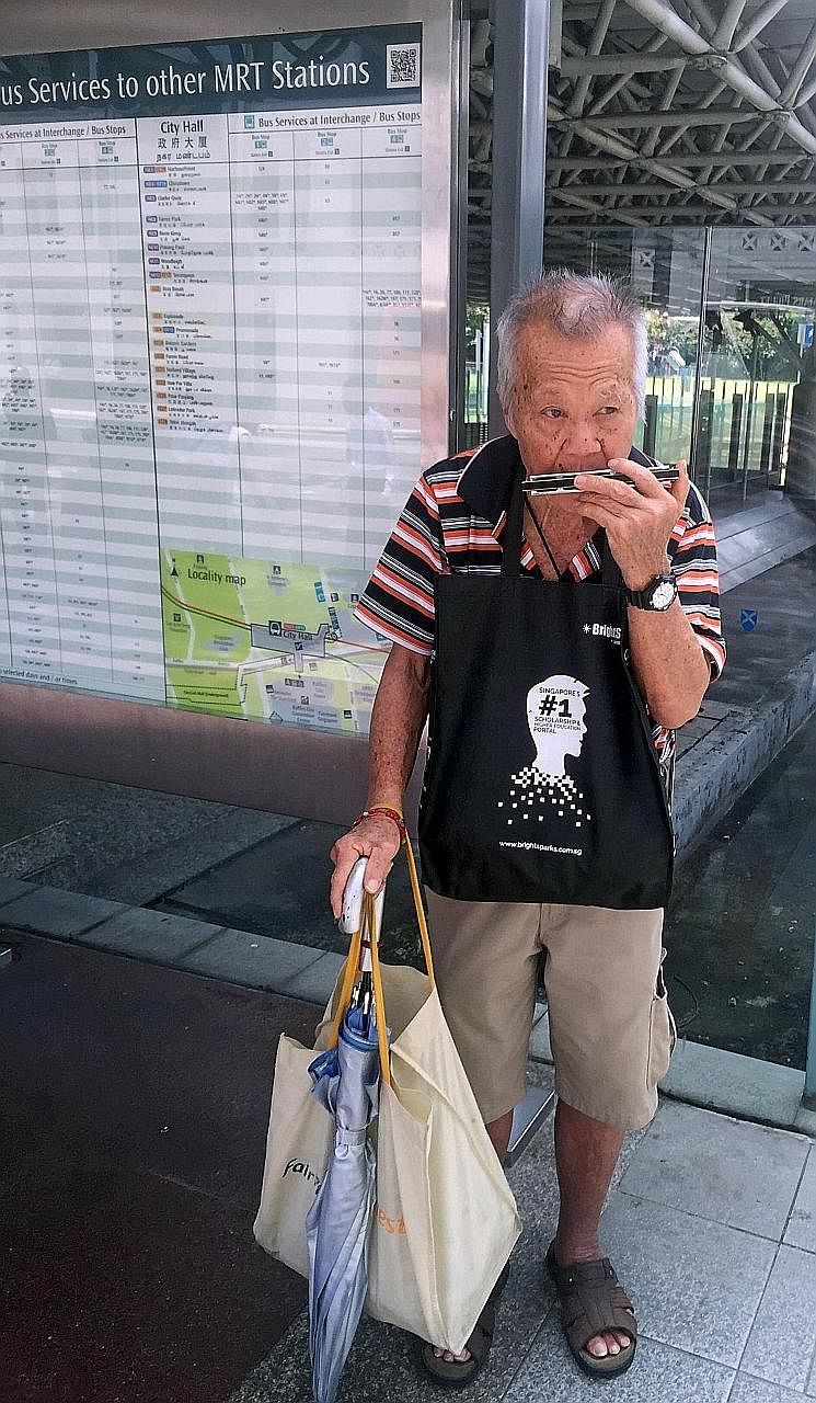 Outside City Hall MRT station, an elderly man played Auld Lang Syne on a harmonica. Members of the public paying their respects to Mr Nathan at Parliament House yesterday. People from all walks of life joined the queues at the Padang to wait for thei