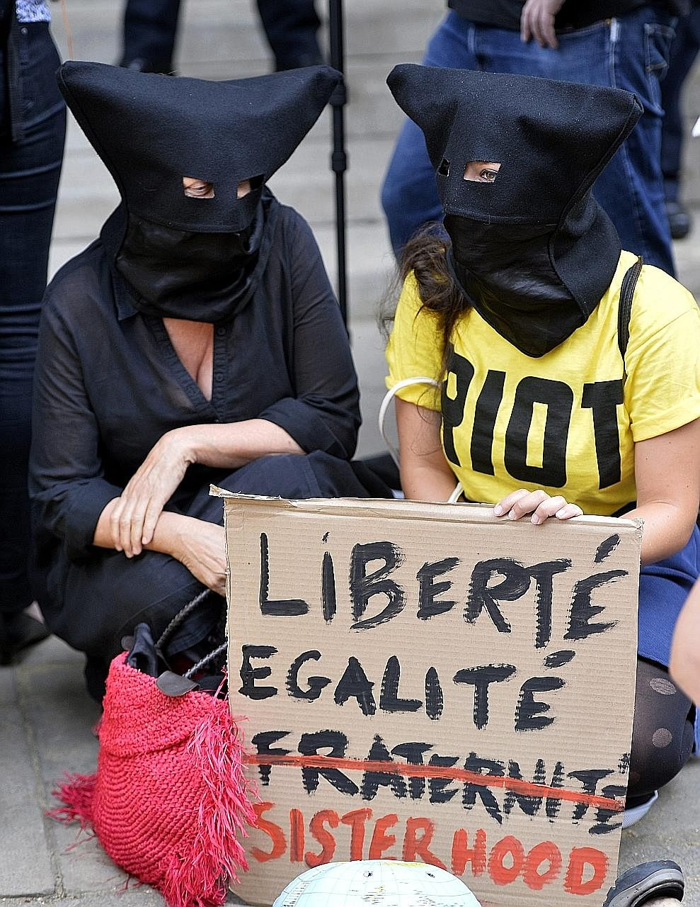 Participants of the Wear What You Want Beach Party protest outside the French Embassy in London. The protest against the burkini ban was held to show solidarity with Muslim women in France.